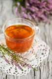 Cup of tea and heather. On the wooden background stock images