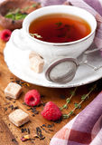 Cup of tea with herbs and berries Stock Photo