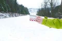 Cup of tea holding in woman hand. Winter background. Hot drink with foam. Snow and cold weather. Coffee break. Concept of drink in. Cup of tea holding in woman Stock Photography
