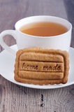 Cup of tea and homemade biscuit Stock Images