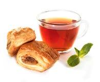 Cup of tea with homemade bun Stock Photo