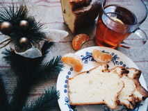 Cup of tea, homemade cake and Christmas-tree branch on the table Stock Image