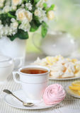 Cup of tea with homemade zephyr Royalty Free Stock Photos