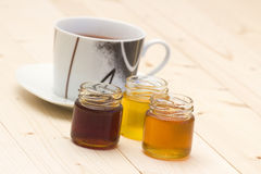 Cup of tea with honey Stock Photography