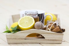 Cup of tea, honey, cinnamon and fresh lemons Stock Photos