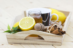 Cup of tea, honey, cinnamon and lemons Stock Photography