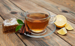 Cup of tea with honey and cinnamon Royalty Free Stock Images