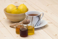 Cup of tea, honey and fresh lemons Royalty Free Stock Images