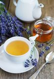 Cup of tea and honey with lavender flowers. On a old wooden table royalty free stock photo
