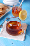 Cup of tea with honey and lemon Stock Images
