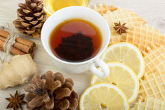 Cup of tea with honey, pinecone, badian, ginger, waffles and cinnamon Royalty Free Stock Photos