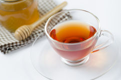 A cup of tea with honey Royalty Free Stock Images