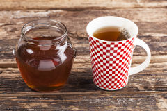 Cup of tea with honey stock images