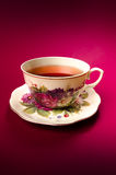 Cup of tea. Hot cup of tea,purple background Royalty Free Stock Photo