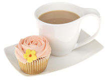 Cup of Tea with an Iced Cupcake Royalty Free Stock Photos