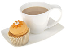 Cup of Tea with an Iced Cupcake Stock Images