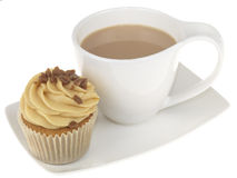 Cup of Tea with an Iced Cupcake Royalty Free Stock Photography