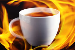 Cup of tea im flames Royalty Free Stock Photography