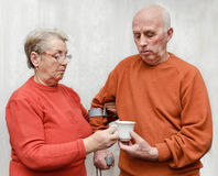 A cup of tea for injured husband Royalty Free Stock Photography