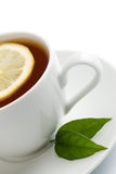 Cup of tea isolated. White cup of tea with lemon isolated Royalty Free Stock Photo