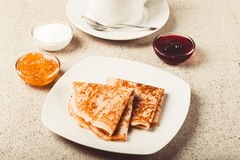 Cup of tea with jam, sour cream and russian pancakes - blini. To. Ned stock photos