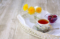 Cup of tea with jam on a tray Stock Photography