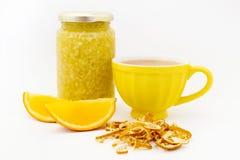 Tea mug with lemon jam and orange slices Royalty Free Stock Image