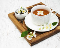 Cup of tea with jasmine flowers Royalty Free Stock Photography