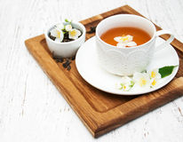 Cup of tea with jasmine flowers Stock Images