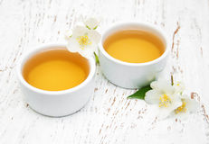Cup of tea with jasmine flowers Royalty Free Stock Photos