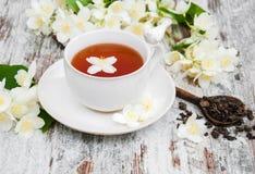 Cup of tea with jasmine flowers Stock Photo