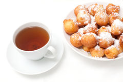 Cup of tea and just baked donuts Royalty Free Stock Image