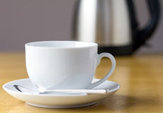 Cup of tea with kettle Stock Images