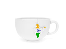 Cup tea label India. Cup of Indian tea with teabag label in the form of India map in national flag colours as symbol of one of the world best maker of excellent Royalty Free Stock Photo