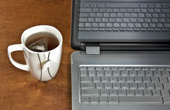 Cup of tea with laptop Stock Photography