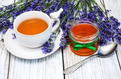 Cup of tea and lavender. On a table royalty free stock photo