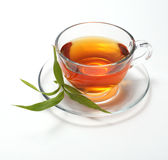 Cup with tea and leaf Royalty Free Stock Photography