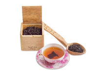 Cup of tea, leaf tea in wooden box and spoon Royalty Free Stock Images