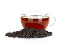 Cup of tea and leaves black tea isolated on white Royalty Free Stock Photos