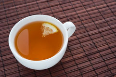 Cup of tea with lemon Royalty Free Stock Image