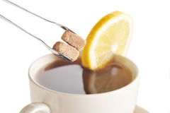 Cup of tea with lemon Royalty Free Stock Photos