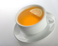 Cup of tea with a lemon Royalty Free Stock Photography