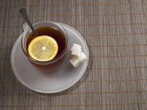 Cup with tea with a lemon Stock Photography