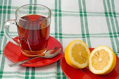 Cup of tea and lemon Stock Images