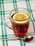 Cup of tea with a lemon Stock Photos