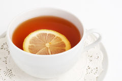 Cup of tea with lemon. On white background Royalty Free Stock Images