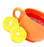 Cup of tea with lemon. Orange big cup of tea with lemon Royalty Free Stock Photos