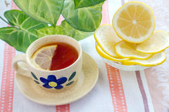 Cup of tea and lemon Royalty Free Stock Images