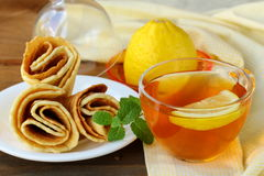 Cup of tea with lemon Stock Photography