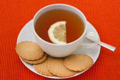 A cup of tea with lemon Stock Images